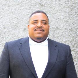 Pastor Charles Mills